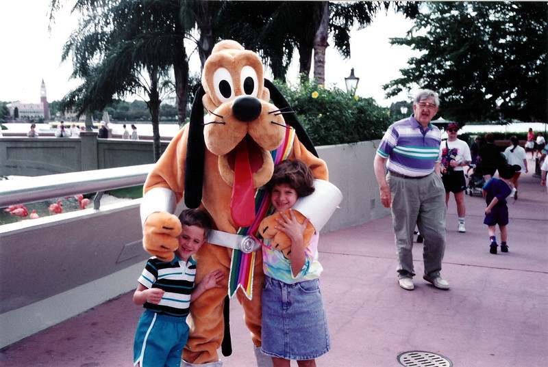 Katie & Tristan with Goofy. Grandpa Jim in the background. 1992 - Epcot