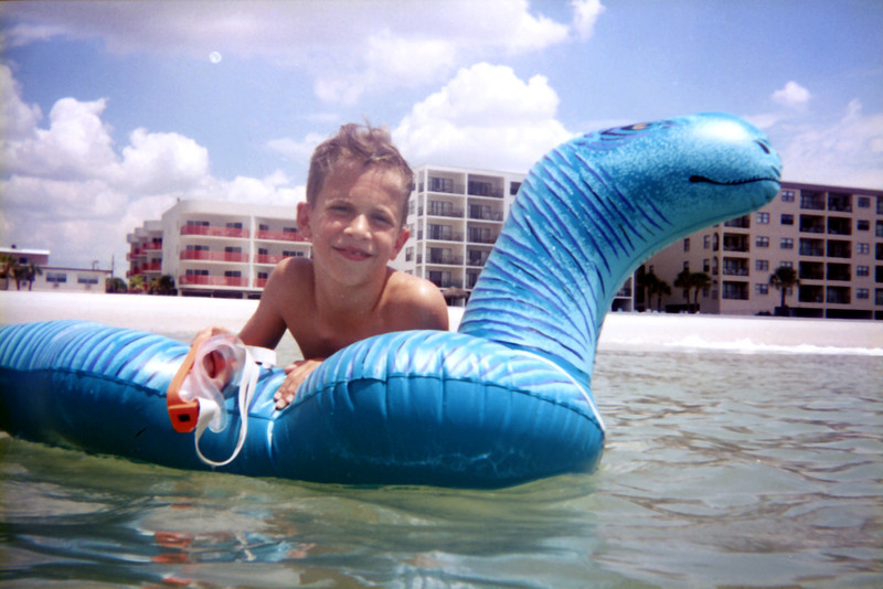 Tristan in the water in Maderia Beach, FL. See the moon in the eastern sky!