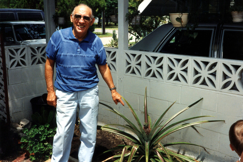 Uncle Joe pointing out his pineapple plant - 1991