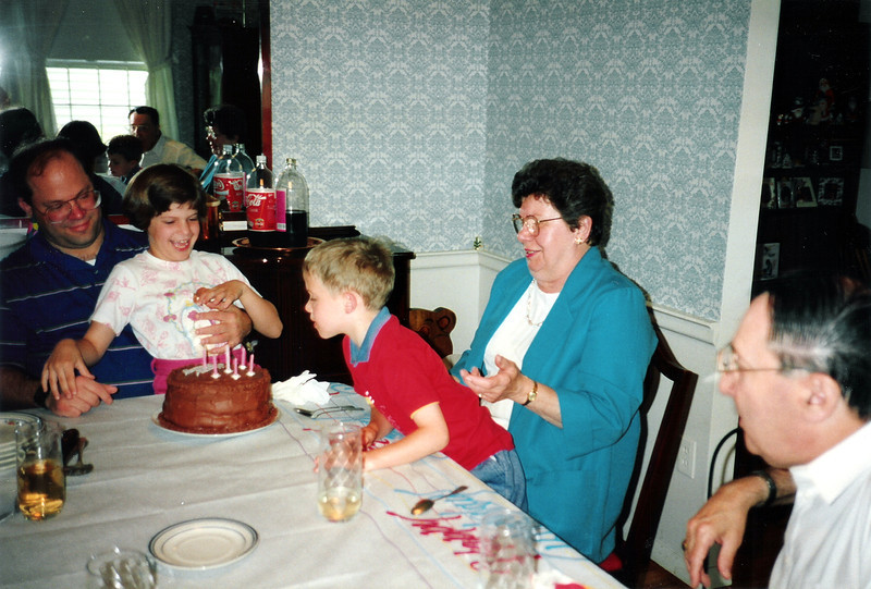 Katie's 6th Birthday with Grandma Ann, Tristan (blowing out her candles) & Grandpa Bill. Wethersfield, 1991