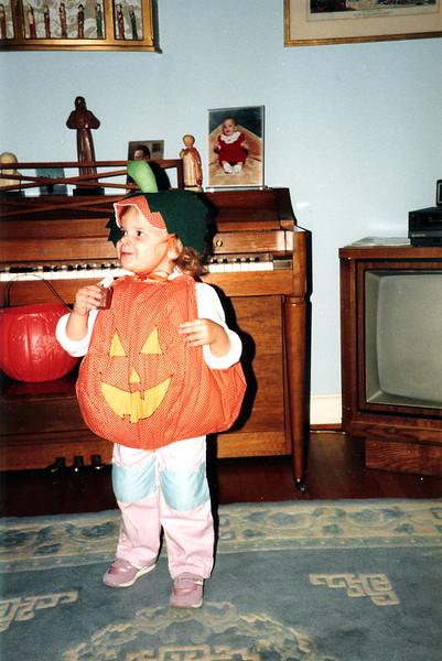 Katie the pumpkin enjoying a candy bar. 1987