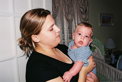 Katie holding her cousin Alex in 2004.