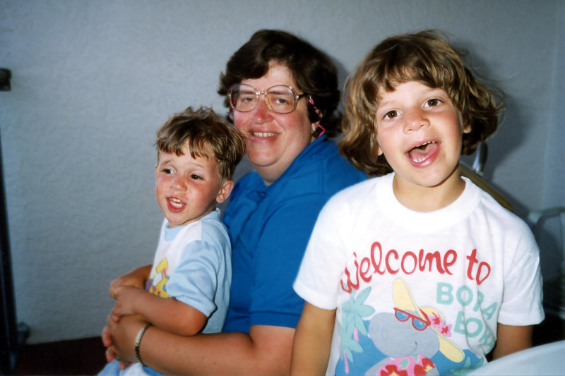 Tristan, Penny & Katie on the balcony at Sandy Shores, Maderia Beach, FL - 1990