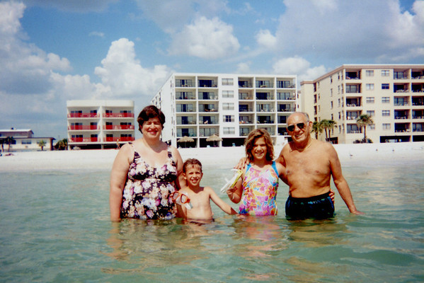 Penny, Tristan, Katie & Uncle Joe with Sandy Shores behind them.