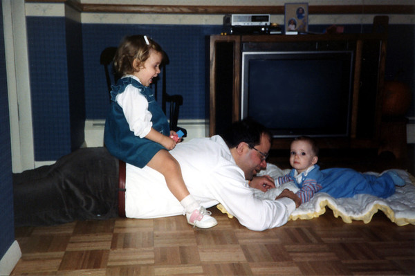 Playing on the floor. 1987