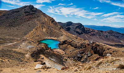 Looking down at one of the  turquoise green colours of the Emerald Lakes from the Red Crater at the peak of the Tongariro Alpine crossing