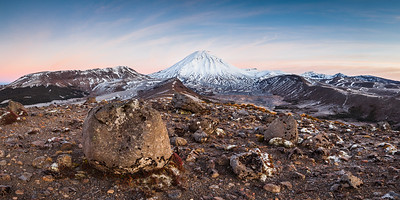 Volcanic boulders and Mount Ngauruhoe with a cap of winter snow, Tongariro Northern Circuit, Tongariro National Park