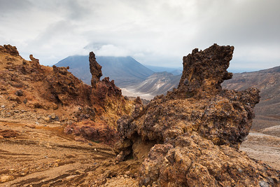 Lava formations on Mount Tongariro with Ngauruhoe in background. Tongariro Alpine Crossing, Tongariro National Park, Central North Island