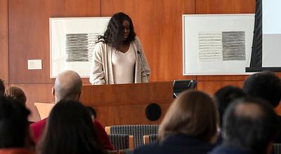 Doctoral student Ola Kalu reads a Toni Morrison passage