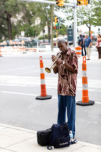 Trumpet player, jazz and street musician, Franklin McCullers plays outside the Tony Bennett ahow at The Fox Theatre in  Detroit on 8-12-16.  Photo credit: Ken Settle