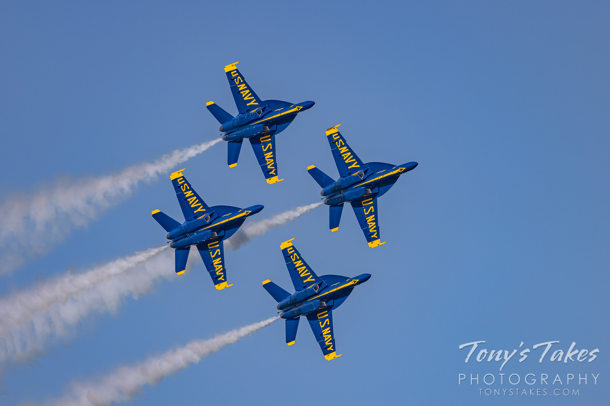 The Blue Angels in their diamond formation fly by. (© Tony's Takes)