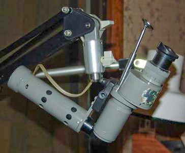These microscopes come with a built in light - which I find to be on the dim side.  I usually remove the light kit and just use the bench lamp - but, a kit is available for every scope for $200..