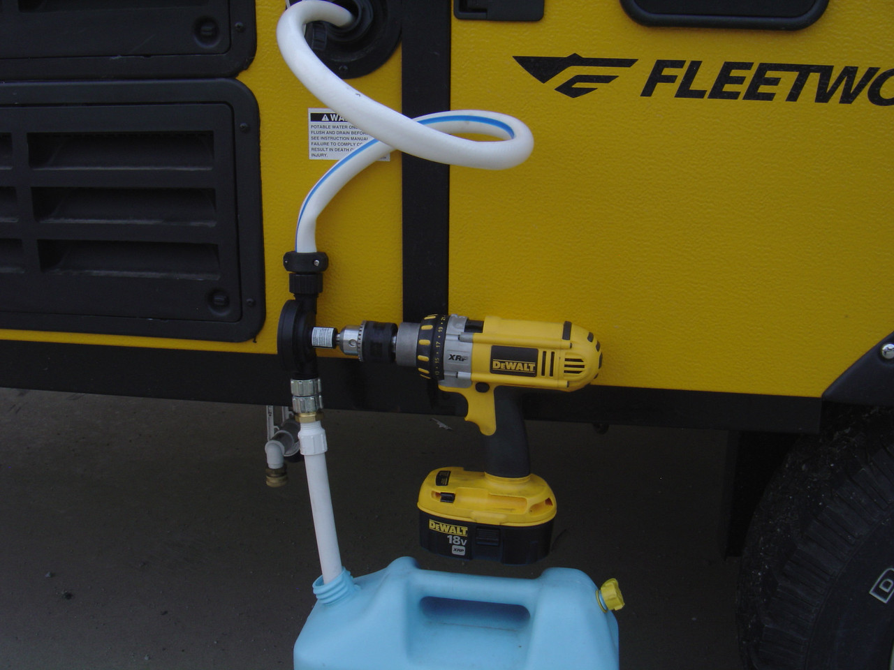 CLose up of drill and water pump.