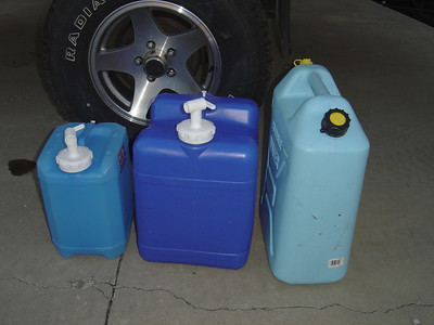 Water containers.  I use either the small (left) or seven gallon (middle) Aquatainers for drinking water. The right container is used either to tote water from a spigot at a campground or as extra water when boondocking.