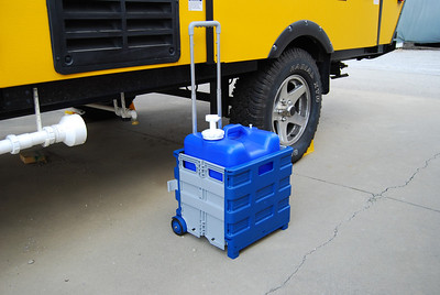 The larger aquatainer fits into this carrier but the small wheels makes it difficult to pull over gravel or grass.