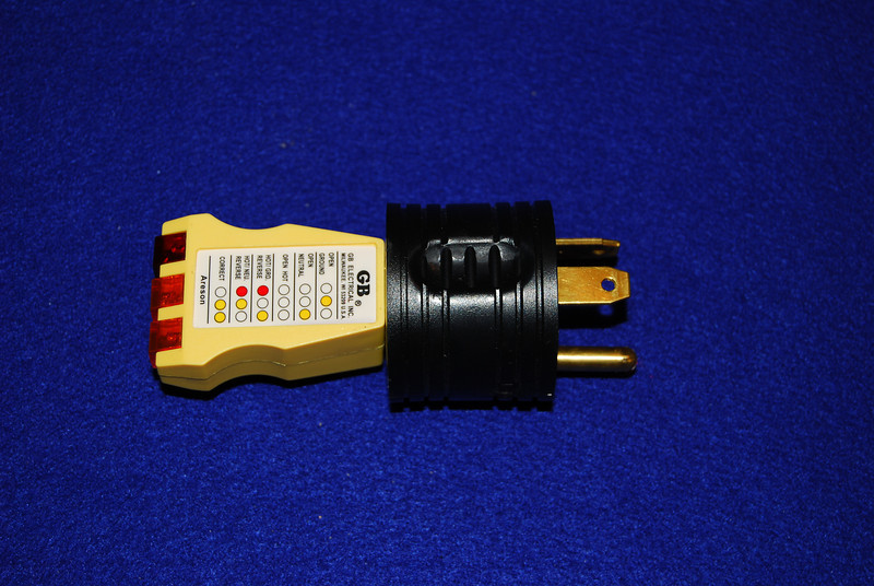 A Circuit analyzer (yellow unit)  allows you to check the polarity and ground of the CG post before you plug in your PUP.  I've attached it to a 30 Amp male / 15 amp female adapter (black unit) so I can plug it into the 30 Amp outlet on the post.