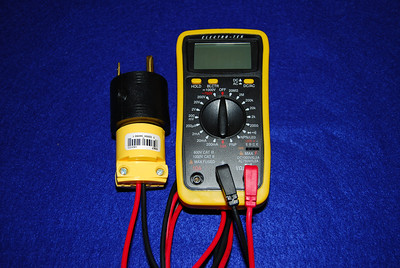 I check the camp ground post volts by pluging this multimeter into the 30 amp out put.  Note -  I cut the end off a extra pair of probes and added a 15 Amp plug.  This is then plugged into a 30 amp male to 15 amp female adapter (black).