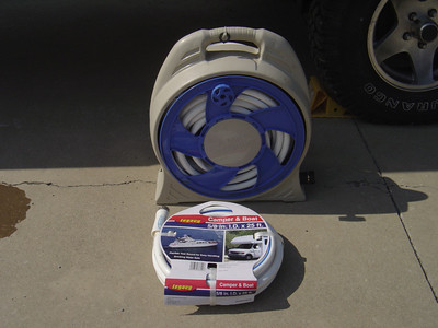 Water hoses.  Note you should purchase white hoses as they are approved of drinking water. To be safe you should have at least 50 feet.