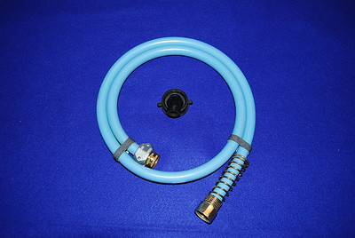 You might need the adapter (shown in the middle) to connect a short peice of hose from the PUP drain to the gray water container.