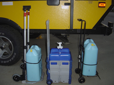 If you are not hooked up to city water you will have to haul water from a camp  ground spigot back to your camper should you run out of water.  For this you will need containers.  However, carrying them can be a pain  unless you use your tow vehicle.  I've tested several folding carriers and found that the heavy duty one on the left with the large wheels works the best.