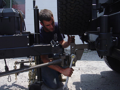 If the weigth of the PUP depresses the back of the tow vehicle, you can use a weight distribution hitch to correct this problem. However, you should check and see if there are any prohibitions from using one on either the PUP (e.g., the frame can't support it) or tow vehicle (e.g., hitch not designed for a WDH).