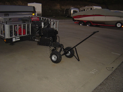 Trailer Dolly.  I've used this whenever I get back from a camping trip at night and my neighbors do not leave me much space to park.