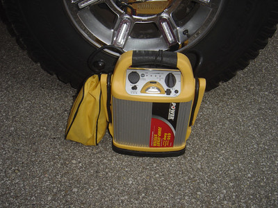 Power on Board (450 Amp battery to jump start or charge cell phones/Black berry). This unit also contains a small air compressor.   Small bag contains Volt meter, 120 volt charger and tire pressure gauge.
