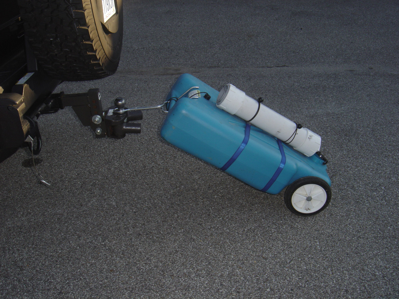 The large commercial tanks have an attachment that allows to haul the gray water tank to and from the dump station.