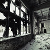 Interior of abandoned dilapidated building. Toned