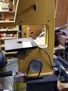Rockwell brand Bandsaw, good for cutting wood or metal depending on band blade installed. Common woodworking tool.