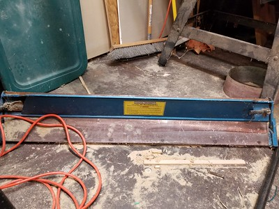 Large gauge metal brake, used up to 90 deg bends in sheet metal.