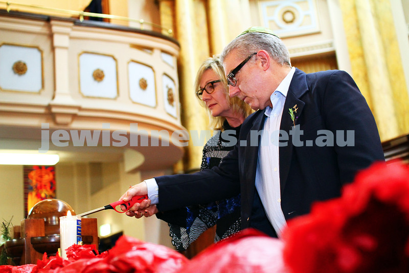 23-4-15. Anzac 100 memorial at Toorak Shul. Felix and Yvonne Sher, parents of Greg who was killed in Afganistan,  light a memorial candle. Photo: Peter Haskin