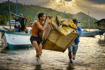 Fishermen in a small village near Baracoa Cuba. I wanted to capture the action here of them bringing in their catch of the day. I've done a sky replacement here because it was blown out in the original and I think it works really well. Fuji XT3, 18-135mm lens, ISO 2000, f/6.4, 1/250th.