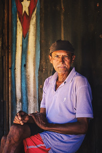 Portrait taken near Baracoa, Cuba in a small fishing village. This is the shack this man lives in and he was happy to pose for us. We tipped him for his kindness and to assist him with his living expenses because this is a very poor area.