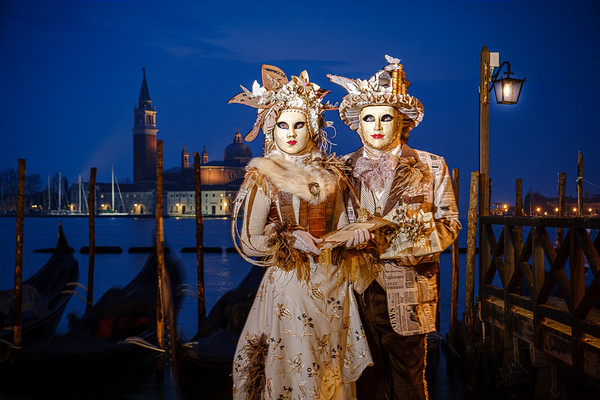 Masked characters before sunrise at Venice Carnival 2020. I used off-camera flash here to light the models and a tripod to get a long exposure for the background.