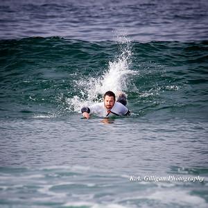 Surfer pulls into a wave at El Porto in Manhattan Beach, CA.