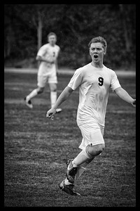 Love the passion in this shot, taken on a cold, rainy fall day.