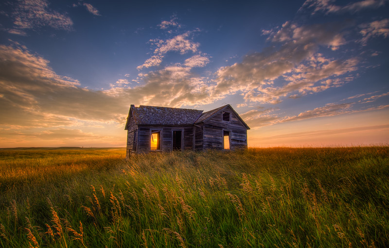 An abandoned farmhouse found in the middle of a wheatfield in eastern Montana.