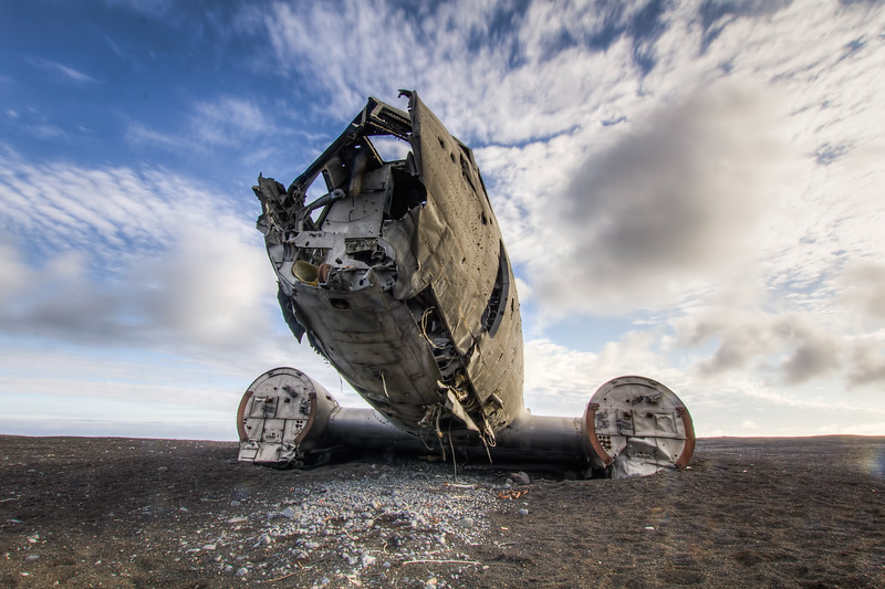 The Lost Aircraft - Over 40 years ago, a US Navy DC3 ran out of fuel, forcing the pilot to crash land on the southern shore of Iceland.  No fatalities.  The aircraft has stayed at the crash site ever since.  Truly in the middle of nowhere with nothing as far as the eye can see except for the Greenland sea and black volcanic sand.