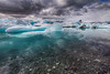 """Jökulsárlón (literally """"glacial river lagoon"""") - The blue color of the icebergs seem to color the water in the lagoon."""