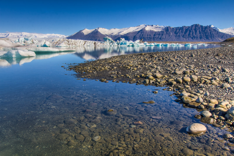 "Jökulsárlón (literally ""glacial river lagoon"") - The lagoon in southeast Iceland where icebergs calve from the Breiðamerkurjökull glacier."