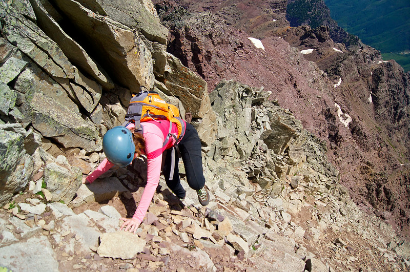 """Nearing the top of the """"green wall,"""" a 500=foot vertical class 4 ascent over crumbling scree and loose rock.  Pyramid Peak; Colorado Elk Range."""