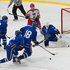 The Lunenburg/Ayer-Shirley defense clears the puck away from G Nathan Bourdelais. SENTINEL&ENTERPRISE/ Jim Marabello