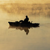 A Fisherman on a foggy Manasquan Reservoir at Sunrise