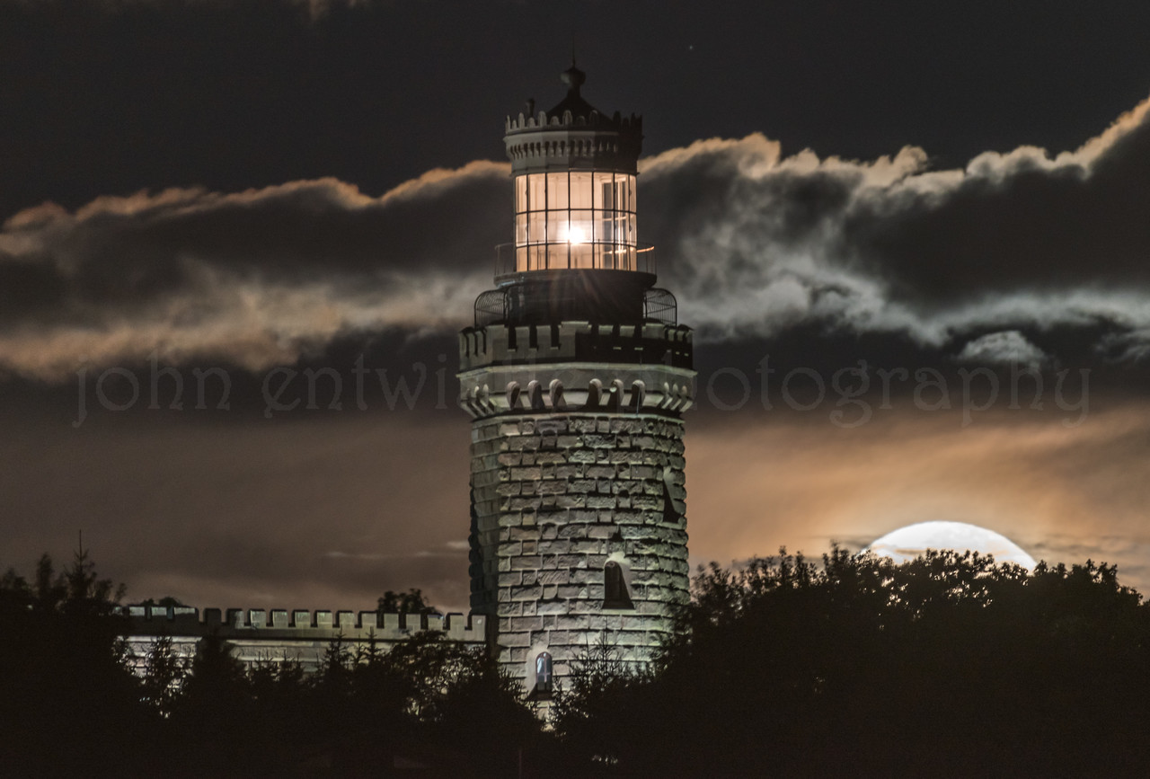 Cloudy Full Moon Setting Over The Twin Lights Lighthouse 10/5/17