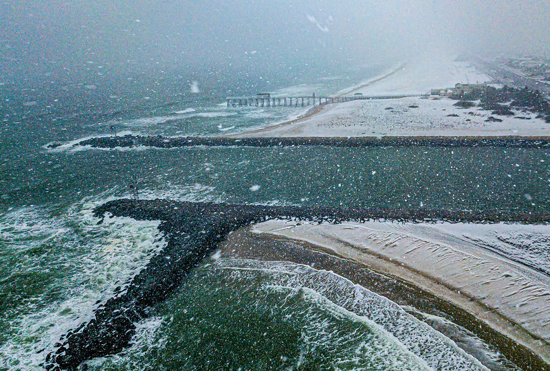 A Snowy Aerial View Of Shark River Inlet and Belmar Pier 2/7/21