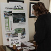 An attendee looks over the plans for the Fitchburg Dog Park at a benefit for it at Chai Bo. SENTINEL&ENTERPRISE/ Jim Marabello