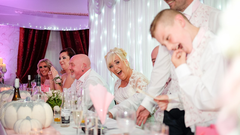 Bride looking shocked and laughing.
