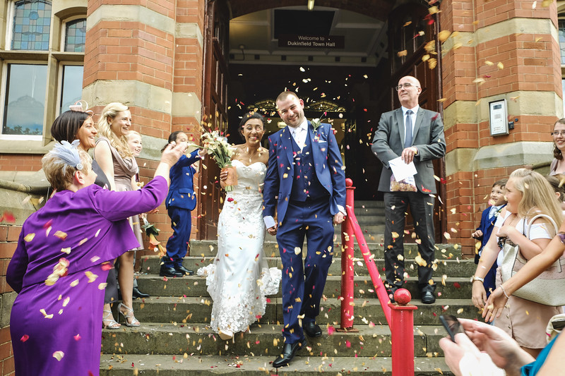 Wedding smiles with confetti.