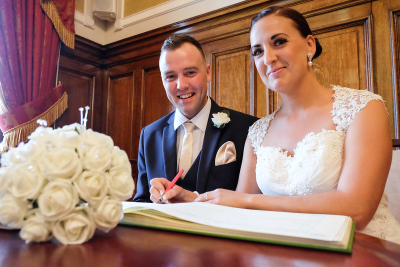 Bride and Groom signing the wedding register